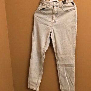Versace women's light wash jeans.
